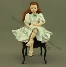 Sitting Girl in Green Striped Dress by Patsy Thomas